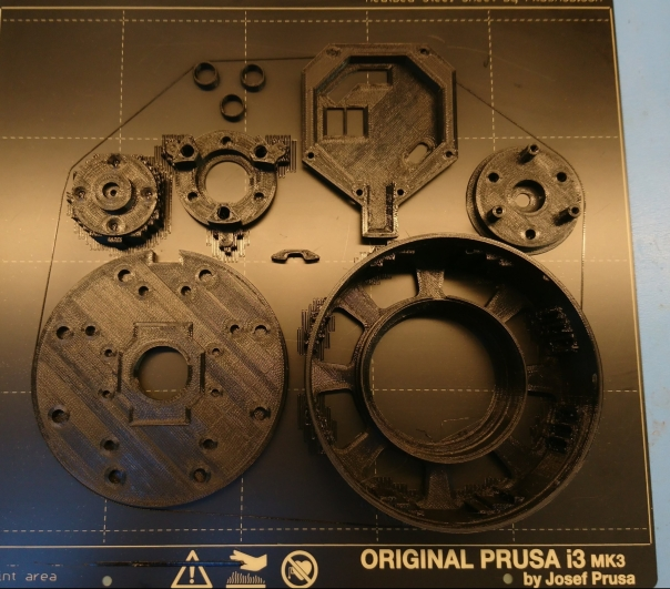 Plastic gearbox parts on build plate