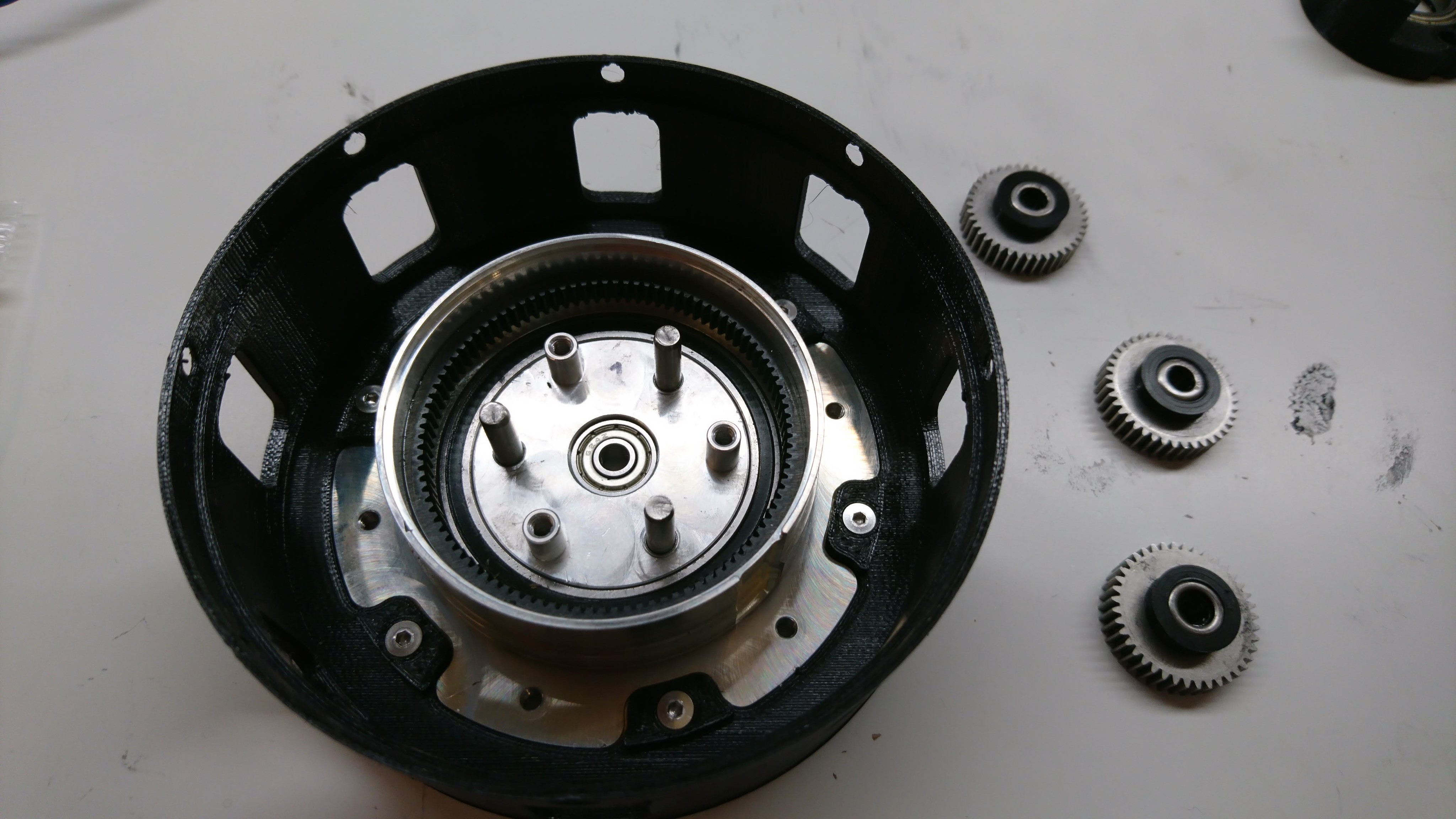 Planet output and planet gears partially assembled